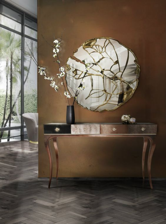The Elegant Untamed Console by KOKET Finished in Metallic Leaf Elegant Console Table The Elegant Untamed Console by KOKET Finished in Metallic Leaf 141a4b6256abc48c3d5f4c2869c2d84d