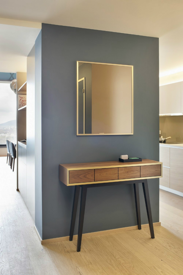 console table How to Match Wall Colors with your Modern Console Table Fancy Wooden Console Table and Square Wall Mirror at Apartment Dyer Smith Frey Hallway Separated Kitchen