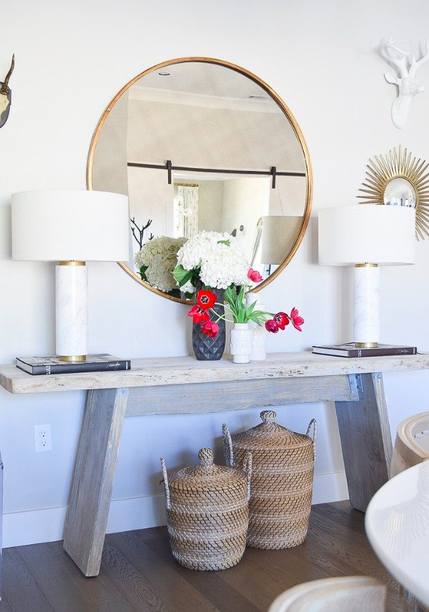 farmhouse style Trends 2017: Farmhouse Style how to make a cozy and inviting home with flowers round gold mirror sw on the rocks modern rustic console table marble and brass lamps baskets under console 3 e1496221463904