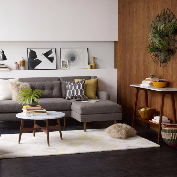 interior inspiration 12 Interior Inspiration Ideas with Marble Console Tables mid century modern living room decor paired with coffee table with marble top and wooden details also paintings