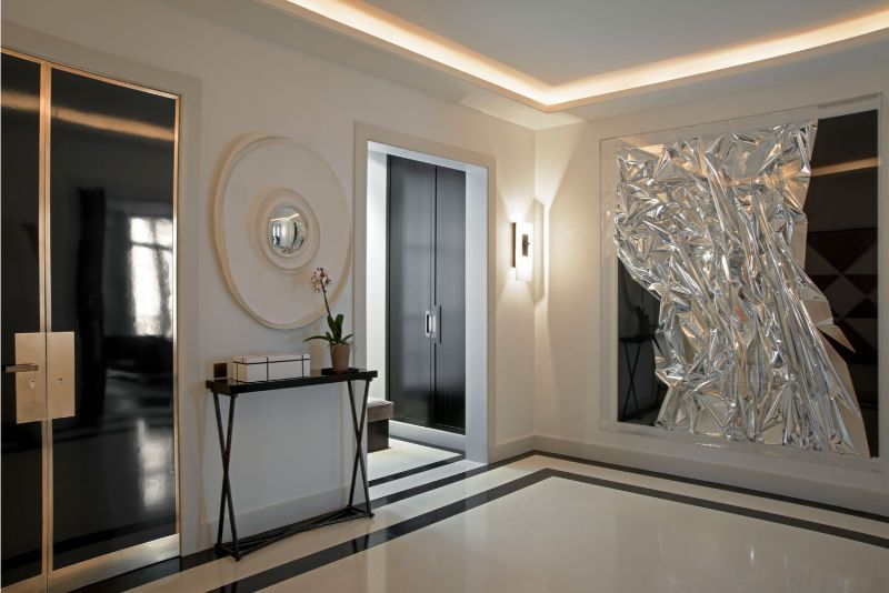 living room Elegant Entryway and Living Room Designs by Champeau & Wilde 1